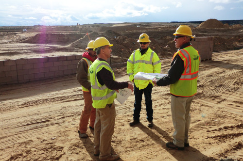 Headsup crew discussing design layout at a cnstruction site