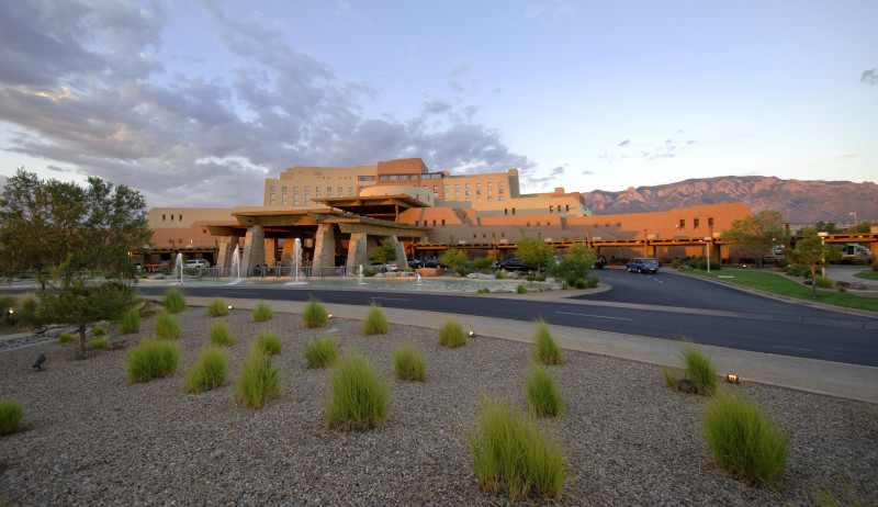 Wide view of Sandia Casino with water feature and xeriscape landscaping
