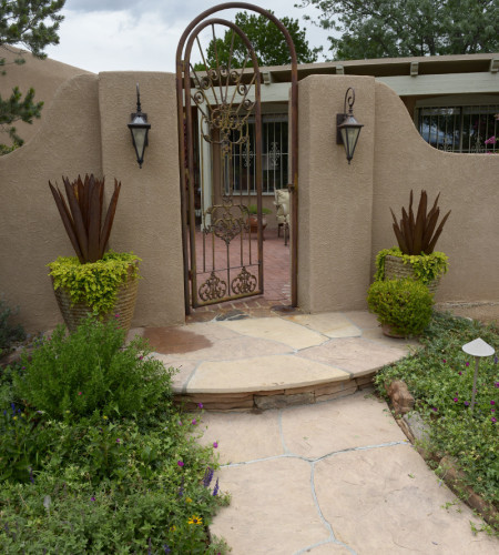 residential landscaping iron gate to courtyard