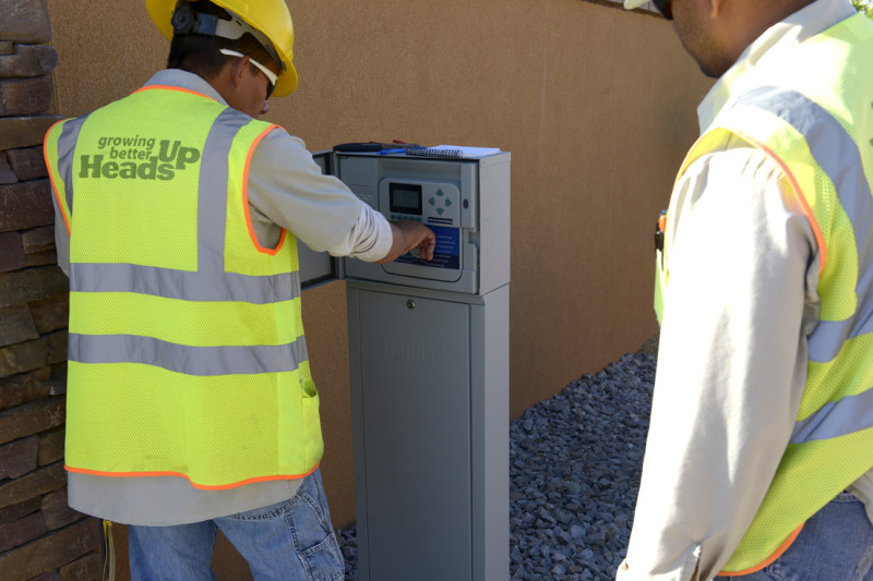 Heads Up Landscapers setting up springler control system