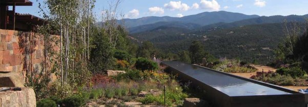 Water feature in mountain landscape at Davis Residence, Santa Fe