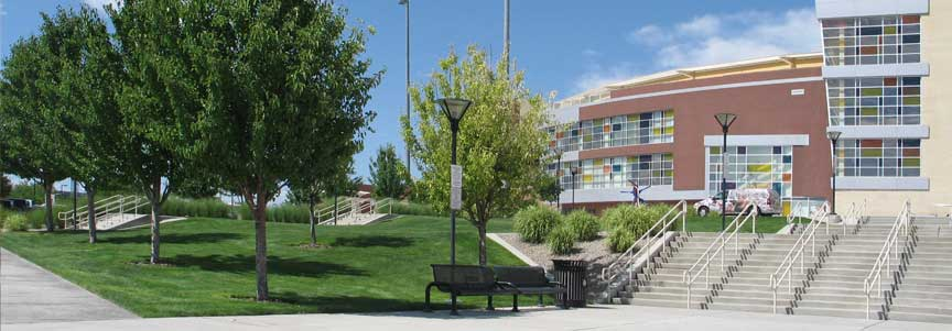 Photo of isotopes park showing grass, trees and steps leading to entrance