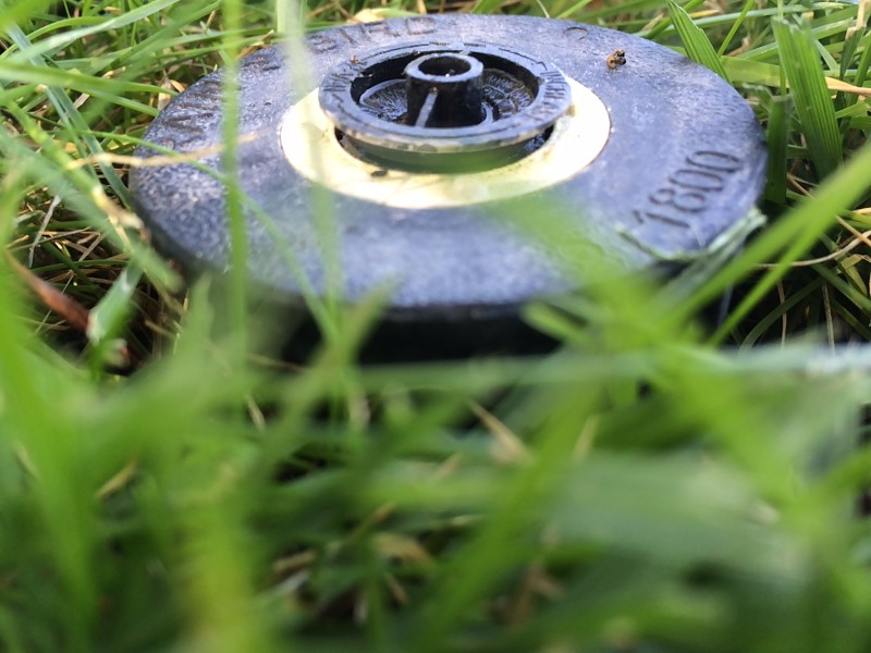 Close up of sprinkler system in grass